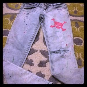 Paint splattered skull jeans